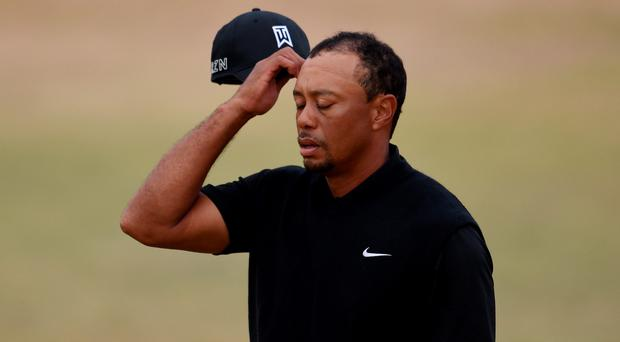 Tiger Woods reacts on the 18th green during the first round of the 115th U.S. Open Championship at Chambers Bay