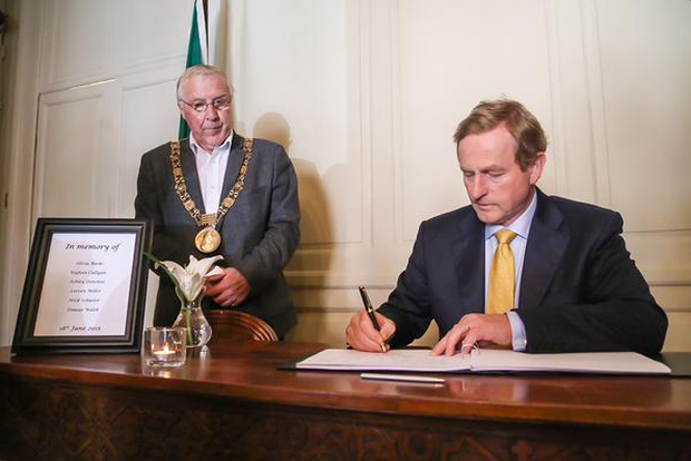 Taoiseach Enda Kenny signs the book of condolence for the Berkeley tragedy victims at Mansion House today. Photo: Twitter/@merrionstreet