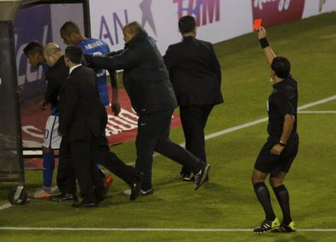 Brazil's Neymar (L) leaves the pitch as he receives a red card from referee Enrique Osses following the first round Copa America 2015 soccer match against Colombia at Estadio Monumental David Arellano in Santiago