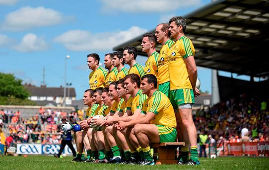 The Donegal team sit for a team photograph before the game with Armagh