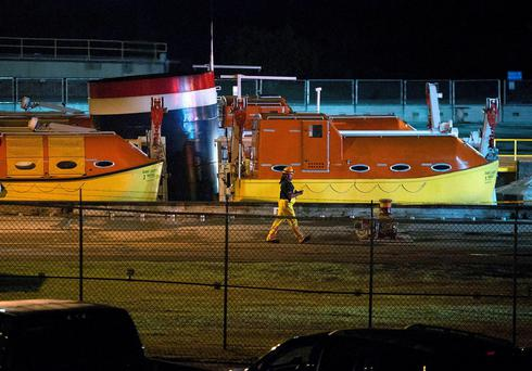 A man walks past the top of the Saint Laurent cruise ship Thursday, June 18, 2015, after an accident in Massena, N.Y. (Jason Hunter/The Watertown Daily Times via AP)