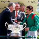 Prince Andrew, Duke of York congratulates jockey Christophe Soumillon (right) after his winning ride on Ervedya in the Coronation Stakes during day four of the 2015 Royal Ascot Meeting at Ascot Racecourse
