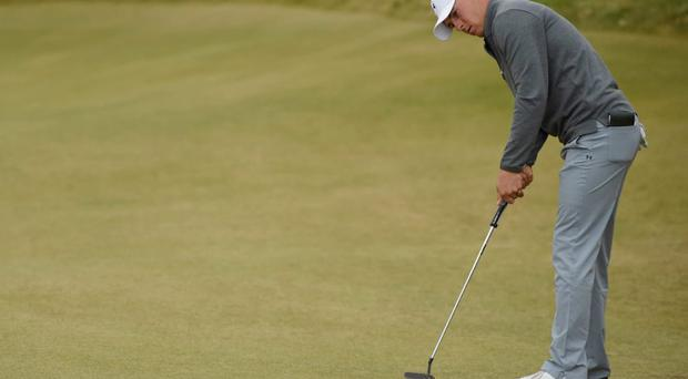 Jun 19, 2015; University Place, WA, USA; Jordan Spieth putts on the 10th green in the second round of the 2015 U.S. Open golf tournament at Chambers Bay. Mandatory Credit: John David Mercer-USA TODAY Sports