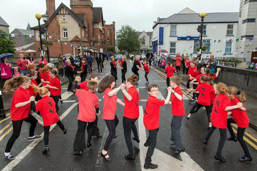 Members of Cos Cos Sean-Nós Dance Company from Rathcormac NS, performing on Hyde Bridge, at the Fleadh Cheoil Open Day in Sligo. Photo: James Connolly