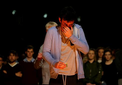 A young man grieves at a vigil in Berkeley