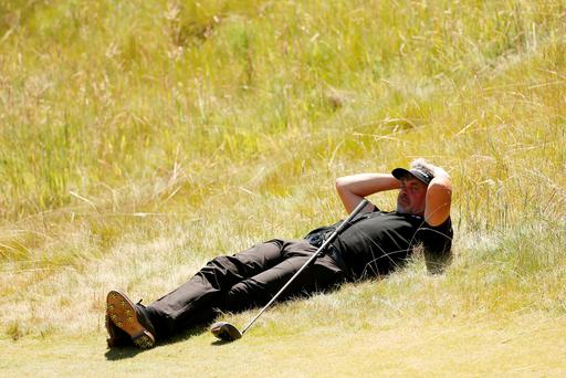Darren Clarke takes a breather during a disastrous second round 80 at Chambers Bay.