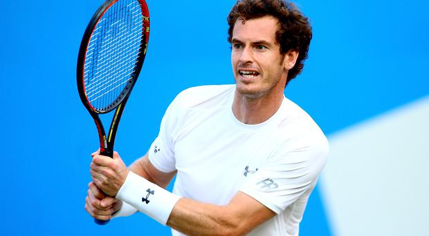 Andy Murray plays a backhand in his quarter-final match against Gilles Muller at Queen's Club