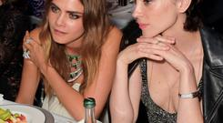 Cara Delevingne (L) and St. Vincent attend the de Grisogono 'Divine In Cannes' party at Hotel du Cap-Eden-Roc on May 19, 2015 in Cap d'Antibes, France.