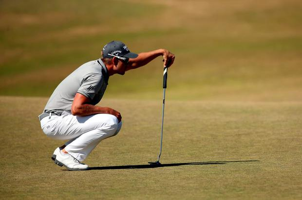Henrik Stenson of Sweden lines up a putt on the 16th green during the second round of the 115th U.S. Open Championship at Chambers Bay