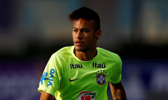 Brazilian Neymar attends a training session in Santiago, Chile yesterday