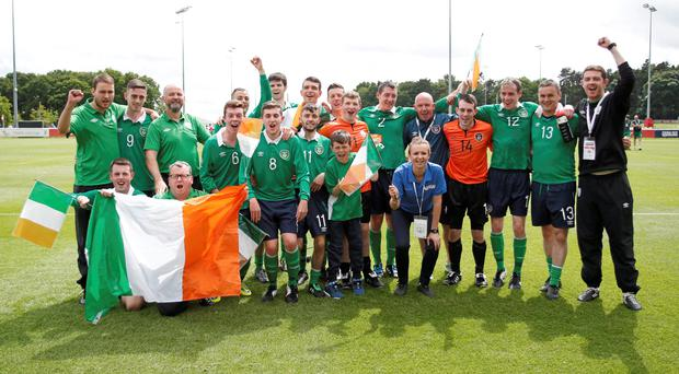 20 June 2015; Ireland players and staff celebrate their victory after the game. This tournament is the only chance the Irish team have to secure a precious qualifying spot for the 2016 Rio Paralympic Games. 2015 CP Football World Championships, Ireland v Portuga. St. George's Park, Tatenhill, Burton-upon-Trent, Staffordshire, United Kingdom. Picture credit: Magi Haroun / SPORTSFILE