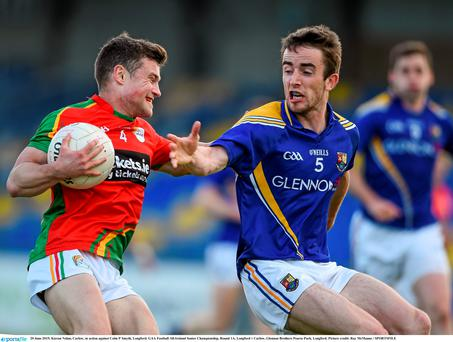 Kieran Nolan, Carlow, in action against Colm P Smyth, Longford. GAA Football All-Ireland Senior Championship, Round 1A, Longford v Carlow, Glennon Brothers Pearse Park, Longford. Picture credit: Ray McManus / SPORTSFILE