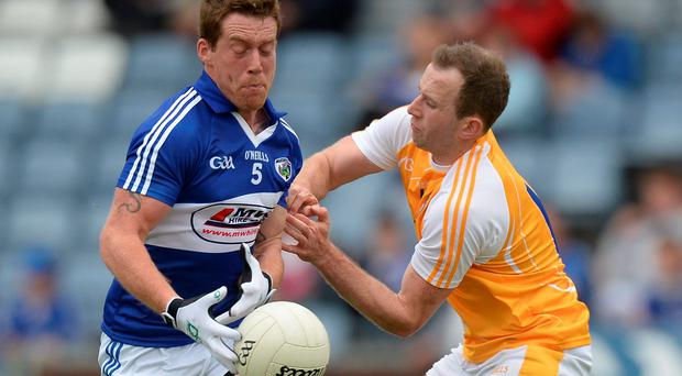Laois wing-back Darren Strong tries to get away from Antrim's Michael Pollock during his side's shock qualifier defeat