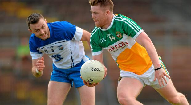 Nigel Dunne charges past Waterford's Tadhg O Huallachain