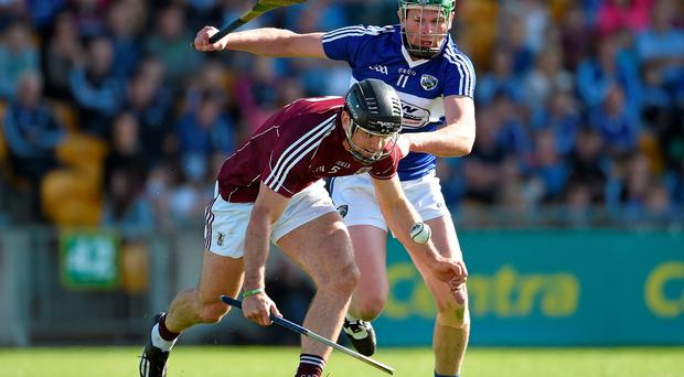 Galway's David Collins gets to the ball ahead of Zane Keenan of Laois during yesterday's Leinster semi-final. Photo: Paul Mohan