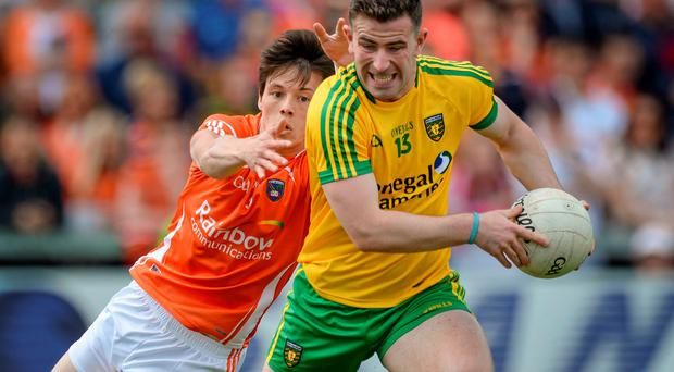 Donegal's Patrick McBrearty breaks through a challenge from Armagh's James Morgan