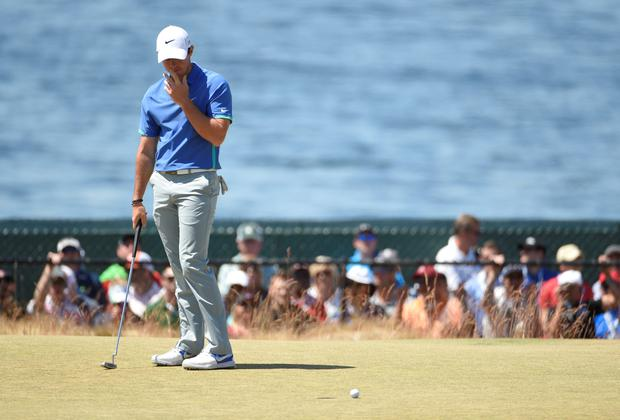Rory McIlroy reacts after missing a putt on the 17th green in the third round of the 2015 U.S. Open golf tournament at Chambers Bay