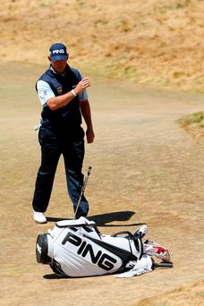 Lee Westwood of England tosses his putter during the second round of the 115th U.S. Open Championship at Chambers Bay