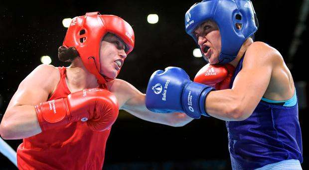 21 June 2015; Katie Taylor, Ireland, left, exchanges punches with Denitsa Eliseeva, Bulgaria, during their Women's Boxing Light 60kg Round of 16 bout. 2015 European Games, Crystal Hall, Baku, Azerbaijan. Picture credit: Stephen McCarthy / SPORTSFILE