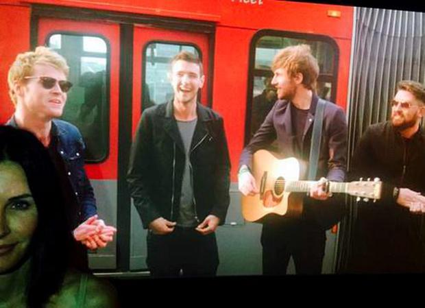 Courtney Cox tweeted a pic of Kodaline from new video Love Will Set You Free