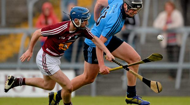 Seán Lancaster does his best to keep up with Dublin's Alex Considine
