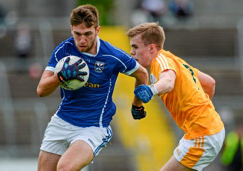 Cavan's Dillon Raythorne charges through a tackle from Donal Carey