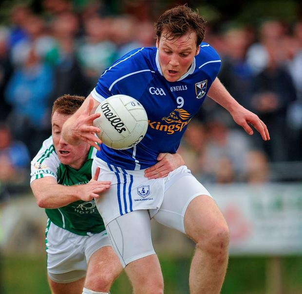 Gearoid McKiernan, who scored a goal and six points for Cavan, is tackled by London's Stephen Curran