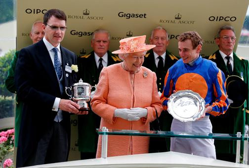Aidan O'Brien (left) and Ryan Moore (right) receiving their Royal Ascot leading trainer and jockey awards from the Queen on Saturday (Alan Crowhurst / Getty Images)