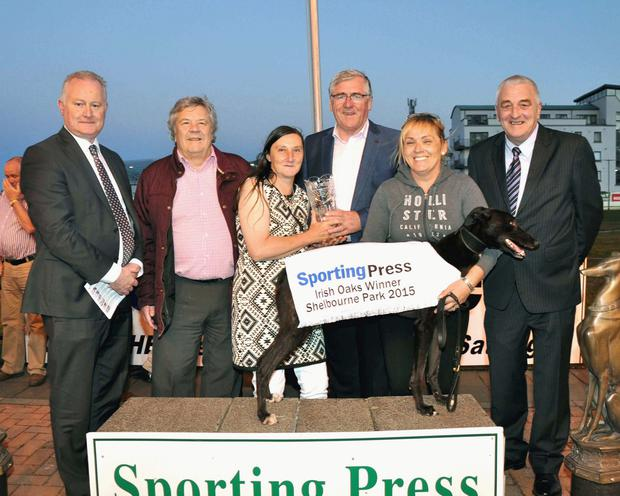 At the presentation after Ballydoyle Honey's victory in the Irish Oak's final were, from left, Irish Coursing Club CEO DJ Histon, Peter McMunn, Alison Coxon, Minister of State Tom Hayes, Nicky Holland (handler) and ICC president Brian Divilly