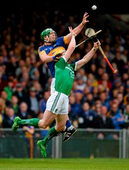 Niall O'Meara of Tipperary fields a high ball ahead of Limerick defender Seamus Hickey at the Gaelic Grounds yesterday