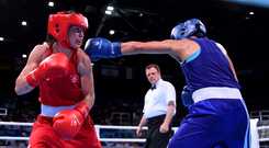 Katie Taylor, Ireland, left, exchanges punches with Denitsa Eliseeva, Bulgaria, during her Women's Boxing Light 60kg Round of 16 bout, on her way to victory in Baku (Stephen McCarthy / SPORTSFILE)