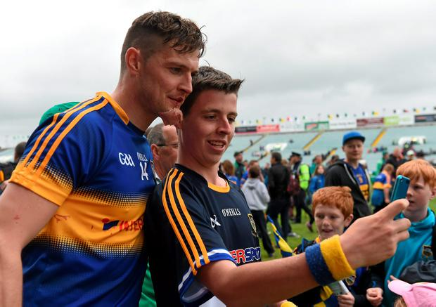 A Tipperary supporter takes a 'selfie' with Seamus Callanan after the game