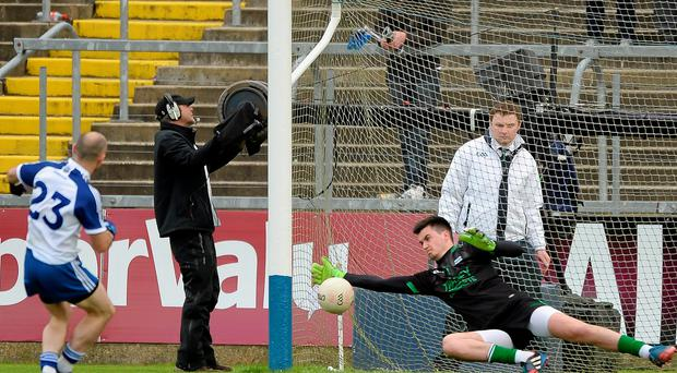 Fermanagh keeper, Thomas Treacy, saves a penalty from Stephen Gollogly