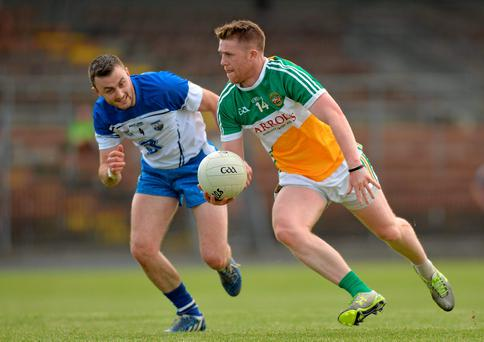 Offaly's Nigel Dunne is tracked by Tadhg O Huallachain