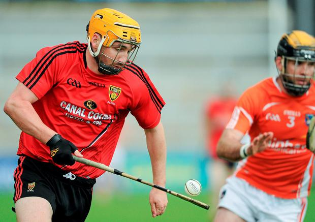 Caolan Bailie is pursued by Armagh's Ciaran Clifford