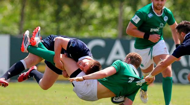 Stephen Fitzgerald is tackled by Scotland's Rory Hutchinson during the World U-20 Championship play-off match in Viadana.