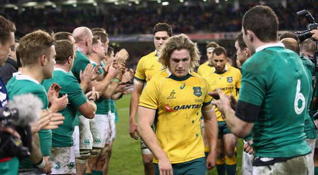 A dejected looking Michael Hooper of Australia looks on after defeat to Ireland in 2014