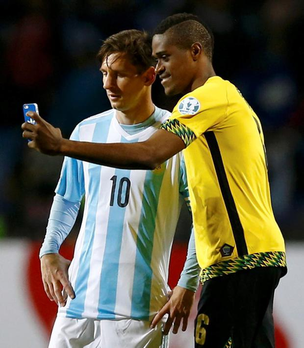 Jamaica's DeShorn Brown takes a selfie with Argentina's Lionel Messi (10) following their first round Copa America 2015 soccer match at Estadio Sausalito in Vina del Mar, Chile on Saturday. Reuters/Ivan Alvarado