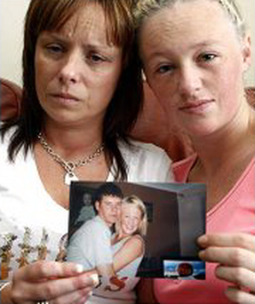 Ashley Dempsey and Martina McQuillan hold a picture of Paul Byrne, whose body was found in 2010.