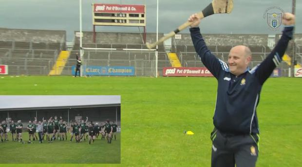 Maor Camán Tommy Hegarty from Clarecastle after hitting the crossbar.