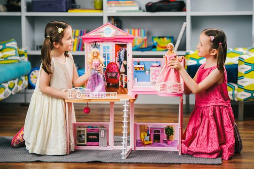 This picture: (l to r) Ines and Elspeth, both aged 6, play house with the new Barbie Style Your Way House that features on Argos Top Toy predictions for Christmas 2015