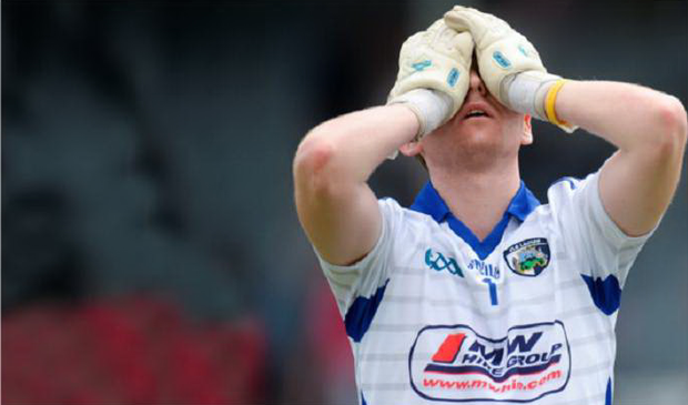 Laois goalkeeper Graham Brody is the picture of dejection after the defeat by Antrim in the Football Qualifier at O'Moore Park, Portlaoise. Photo: Sportsfile