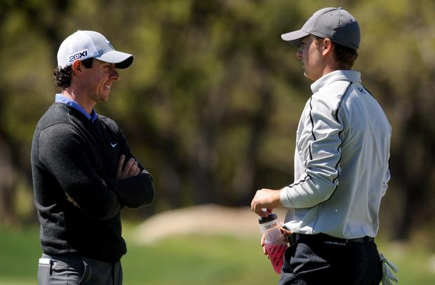 Rory McIlroy talks with Jordan Spieth on the 6th hole during the first round of the Valero Texas Open