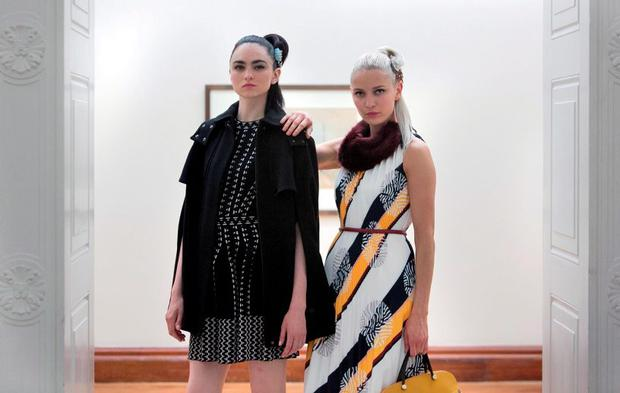 (L to R) Models Maria wearing an Orla Kiely black crepe cape, M Missoni black white knit dress & Teo wearing a Raoul pleated dress, Blanche in the Brambles burgundy collar, Furla multi way bag during the launch of Arnotts new Ladieswear and Menswear Collections for Autumn/ Winter 2015 at Hugh Lane Gallery, Dublin. Photo: Gareth Chaney Collins