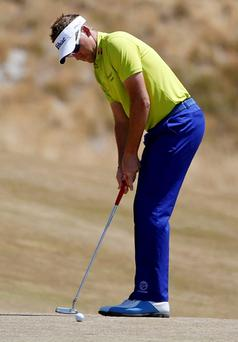 Ian Poulter, of England, putts on the first hole during the final round of the U.S. Open golf tournament at Chambers Bay on Sunday, June 21, 2015 in University Place, Wash. (AP Photo/Lenny Ignelzi)