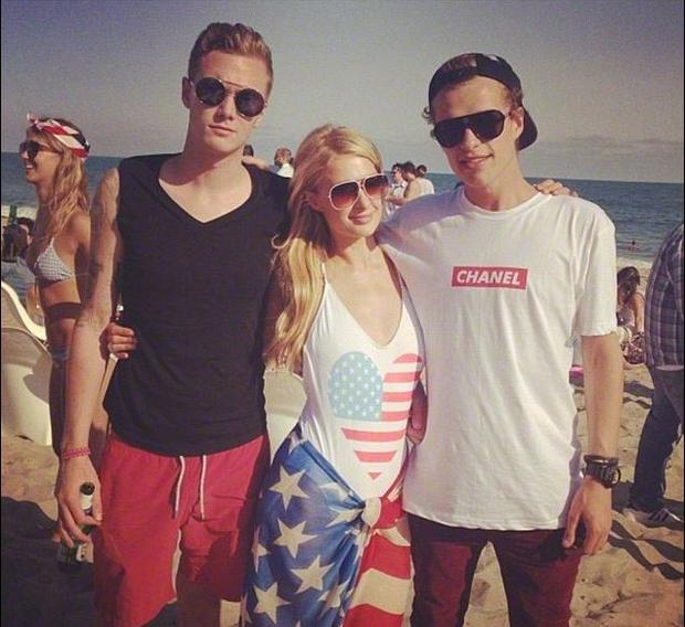 Paris Hilton with brother Conrad (right) and Barron Hilton II