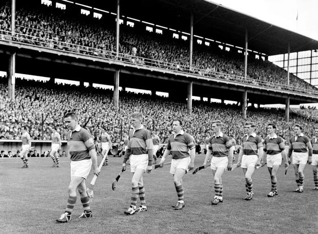 The Tipperary captain Jimmy Doyle leads the Tipperary and Wexford teams duirng the parade ahead of the 1965 All-Ireland against Wexford