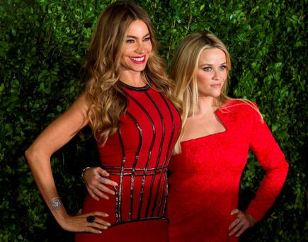 Colombian actress Sofia Vergara (L) and US actress and Oscar winner Reese Witherspoon pose for photographers during the premiere of the film