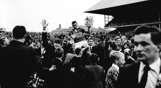 Tipperary's Jimmy Doyle holds the Liam MacCarthy Cup as he is held aloft by Tipperary supporters after his side's vitory over Wexford in 1965. All Ireland Senior Hurling Championship Final, Tipperary v Wexford, Croke Park, Dublin. Picture credit; Connolly Collection / SPORTSFILE