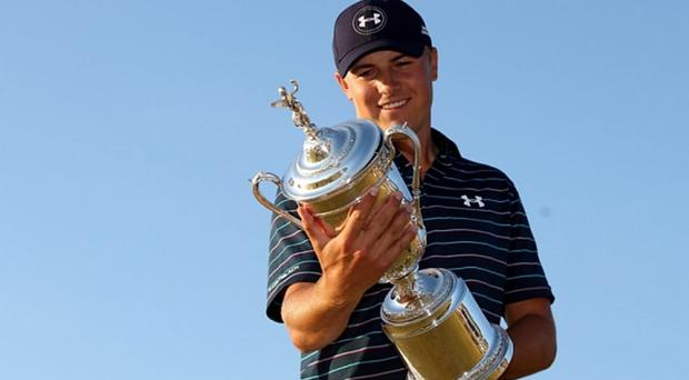 Doing the double: Jordan Spieth with his second major trophy of 2015 Photo: Getty Images